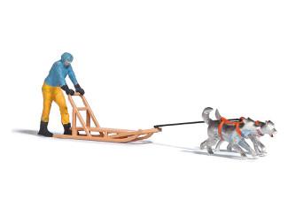 Busch H0 7817 persoon op Hondenslee voorgetrokken door 2 honden - Modeltreinshop