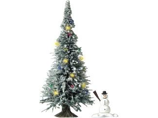 Busch H0 5409 besneeuwde kerstboom, met 7 gele LEDs als verlichting, kerstballen en een sneeuwpop - Modeltreinshop